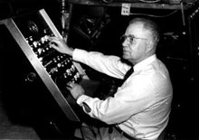 Norman Herrett at the controls of his hand-built planetarium.